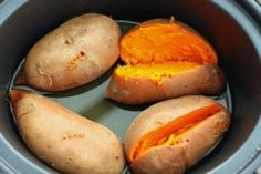 After you rinse and scrub the outsides of them, just put them straight into the crock pot. There's no need to dry them – the liquid leftover on the potatoes from rinsing is all the liquid they'll need. Then set the crock pot to low and cook for 6-7 hours (for 4 potatoes at a time). You should end up with perfect sweet potatoes with basically no effort required.