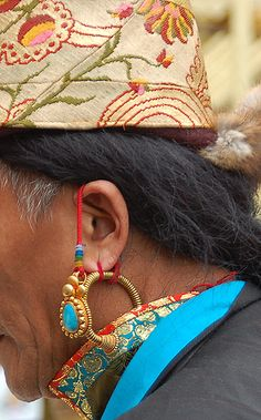 Detail view of complicated earring system. #TibetanPhotojournalism