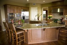 Multi-sided kitchen with U-shaped island with two dining counter sections - one on each side the island.