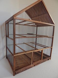NOTE: Price of this cage is lowered because I am not fully satisfied with the look of wire, wire at some places does not shine as it should , and it can not be seen on photographs  Brand new, unused, handmade wooden bird cage Cage is made from WALNUT and GALVANIZED wire, wire spacing is about 0,4 inch and is painted with linseed oil, 9 rungs plus one with swing, feeder, tray Size: lenght-23,4 inch (60 cm) width-14,8 inch (38 cm) height- 30,2 inch (77,5 cm)