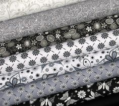 Eight fat quarters of in black, white, and grey make up this bundle! At $12.60 thats only $1.57 per fat quarter! Great to build your stash! Fabrics are from RJR, Maywood Studios, Marshall Dry Goods, and Fabri-Quilt. All are top quality 100% cotton quilting fabric. A fat quarter measures 18 x 22. Special shipping price for this bundle is only $3.50!  Back to my shop: http://www.etsy.com/shop/fabric406  For more sale fabrics visit https://www.etsy.com/shop&#x2...