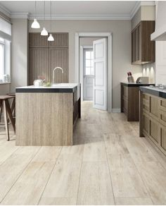 "Bring the warmth of nature into your home with Vogue. It's harmonious qualities makes it adaptable for any design solution. The color body porcelain aspect of Vogue offers a practical alternative to real wood. Vogue is available in four colours: Bianco, Antracite, Tortora and Tabacco in 8""x48""."