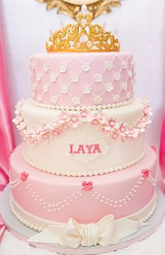pink princess birthday cake with gold and crystal crown topper