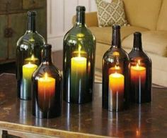 Cut the bottoms off wine bottles and use as candle covers. Also keeps the wind off them when outside
