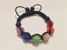 A personal favorite from my Etsy shop https://www.etsy.com/listing/271283847/shamballa-bracelet-gay-pride-colors-clay