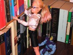 Barbie in a library w/ Skeletor? weird, but in an awesome way.