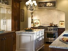 Soothing combination of stained wood and white-painted cabinetry. . . nice recessed cooking alcove with built-in niches for spices, oils, etc.