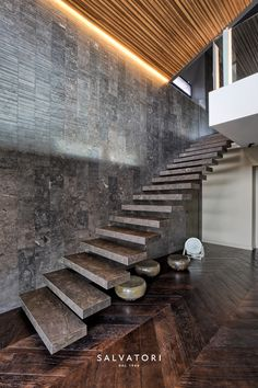 Stairs in Pietra d'Avola limestone and wall in Raw texture, Italian private home, thanks to MG2 architetture and Pepe Fotografia