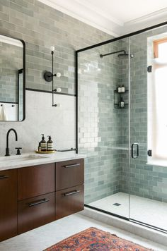 calm modern bathroom - seafoam green tile, marble, wood, black fixtures