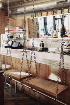 Swing seats (instead of bar stools) at Molly's Cupcakes as seen on Pillow Thought.