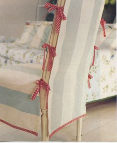 Simple sewing project- an elegant dining chair slipcover in a wide stripe with red woven ribbon trim.