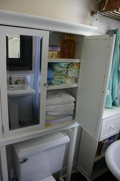 Bathroom storage - idea!  In our tiny bathroom, add an over toilet storage center for baby things: the hooded towels, washcloths, baby shampoo, etc.  One less thing to store in the nursery!