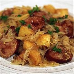 Use CSA potatoes and hakurei turnips. This German-inspired one-skillet dinner combines smoked sausage slices, potatoes, sauerkraut, ale and whole grain mustard for a quick and hearty meal. Saurkraut And Sausage, Sausage Potatoes, Sausage And Peppers, Smoked Sausage And Sauerkraut Recipe, Sliced Potatoes, Kielbasa Sausage, Recipe For German Sausage, Smoked Sausages, Sausage Recipes