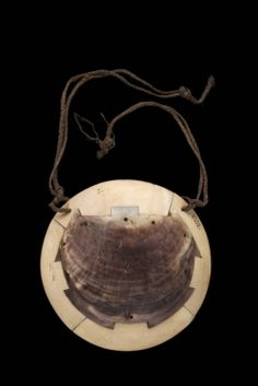 Breastplate, Civavonovono Breastplate composed of four sections of whale ivory enclosing a turtle-shaped piece of pearl shell. Koroinasau, Nadroga, Viti Levu, Fiji. Collected by A. von Hügel, 5 August 1876.