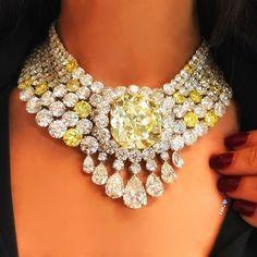 An unforgettable moment at Sothebys , wearing a 102.50 carat intense yellow cushion shape diamond!