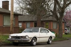 OLD PARKED CARS.: 1973 Mercury Comet.