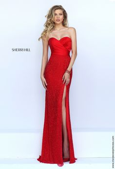 Stunning Sherri Hill red carpet or pageant gown. Features a perfect sweetheart neckline on shimmering satin and a gorgeous fully beaded skirt with a high slit. View Size Chart