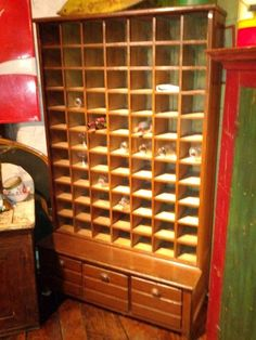 Antique pine display case or apothecary cabinet with 77 compartments from a Quebec general store. On Kijiji Montreal.