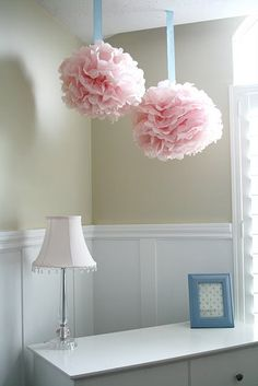 Light pink Pom poms. Would look better in teal, lime green, or blue to match my room. But they are absolutely fantastic!