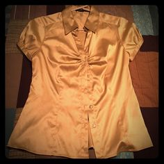 The Limited Satin button down top Satin button down with button detail on the sleeves. Great for work by itself or under a blazer. The Limited Tops Blouses