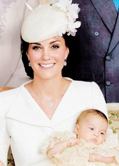 Kate Duchess of Cambridge holding  her daughter Princess Charlotte.  July 5th 2015