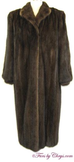 Mahogany Mink Coat #MM795; $1200; Excellent Condition; Size range: 10 - 14. This is a gorgeous genuine natural mahogany mink fur coat. It has a Saga Mink label and features a small shawl collar, blousy sleeves ending in banded bracelet cuffs, and built-in shoulder pads.  The mink fur is very shiny and silky soft. This is the classic mahogany mink coat that will make you feel as elegant as you look when you wear it!
