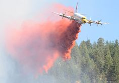 An air tanker drops fire retardant on a two-hectare fire in Penticton Thursday afternoon. Two air tankers and two helicopters fought the fire along with members of the BC Wildfire Management branch and Penticton Fire Rescue. - Mark Brett/Western News