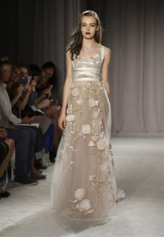 The Marchesa Spring 2014 collection is modeled during Fashion Week in New York, Wednesday, Sept. 11, 2013. (AP Photo/Seth Wenig)