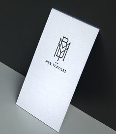 Logo and business card with textured paper and foil deboss for MYB Textiles, a lace manufacturer located in Newmilns, Ayrshire, designed by Graphical house. Opinion by Richard Baird