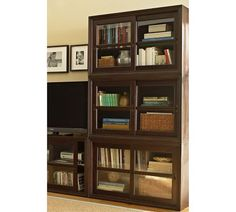 Winslow Glass Cabinet | Pottery Barn - perfect for keeping grubby little baby paws off my books