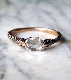 'RAPTURE' - Diamond-headed snakes hold a sparkling, over 1/2 carat