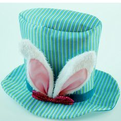 """Striped Fabric Top Hat with Bunny Ears Size: 9.5"""" Color: Blue Fabric hat (can be stuffed for fullness) with white plush bunny ears and a small bow. Ships flat. Arriving early 2015"""