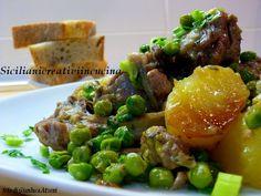 Stufato d'agnello con piselli e patate
