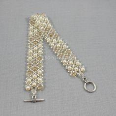 Swarovski crystal golden shadow and cream pearl bridal cuff bracelet. Beaded Wedding Jewelry, Swarovski Jewelry, Crystal Jewelry, Bridal Jewelry, Swarovski Crystals, Bridal Cuff, Pearl Bridal, Beadwork, Beading