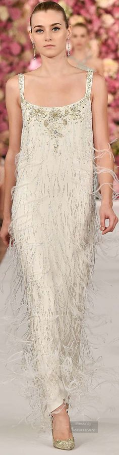 Oscar de la Renta.Spring 2015.  I adore anything with feathers;  must be a headache to keep but must also be the height of luxury
