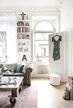 MODERN PARISIAN APARTMENTS: #eclectic living room with white walls + tufted #chesterfield sofa