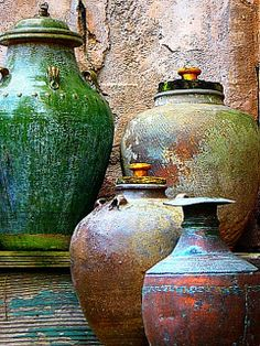 I've loved this photo for years. I think this is original source link.  A pottery exhibit in the Asia Village at Animal Kingdom, Orlando, Florida. Wonderful textures and colors, emphasized by their placement in an area that's also full of texture. Photo featured on the front page of Flickr Bronze Award for receiving 10 awards or more from Your Art has touched the World in July 08. Color Photo Award - SILVER trophy. Rough Things Theme, July 2009.