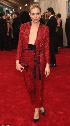 Red hot: Sienna Miller looked fashionable as ever on the red carpet at the Costume Institu...