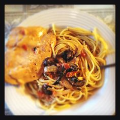 Sauteed chicken in mushroom wine sauce served with buttered garlic spaghetti. It was delish
