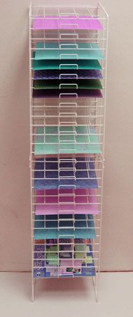 Wire rack paper storage, also great for storing sheets of vinyl - Modern Diy Vinyl Storage, Craft Room Storage, Craft Organization, Storage Ideas, Organizing, Scrapbook Paper Storage, Space Crafts, Craft Space, Vinyl Sheets