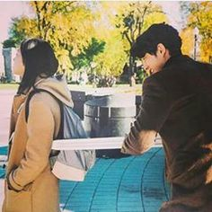 Kim go enu and Gong yoo having fun in the set of Goblin with the sward.