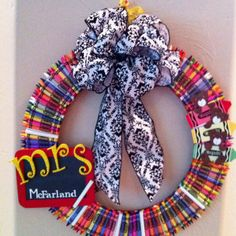 Crayon wreath for teacher gifts or back to school decoration. Made with two embroidery hoops, bear paper piecings, crayons, ribbon, and lots of hot glue.