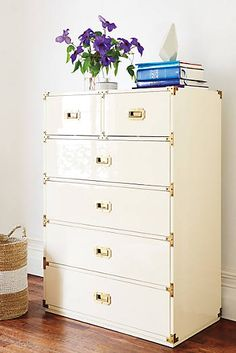 * I like this high gloss cream laquer with the brass fixtures--try black with Chinese red underneath* Lacquered Wellington Six-Drawer Dresser Anthropologie.com