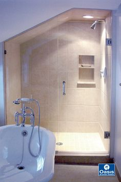 Smaller spaces with tricky angles are ideal for a custom frameless shower. This shower features a dormer cut fixed panel with wall mounted frameless door. Frameless Shower Enclosures, Frameless Shower Doors, Bathroom Shower Doors, Glass Shower, Upstairs Bathrooms, Under Stairs, Panel Doors, Corner Bathtub, Glass Door