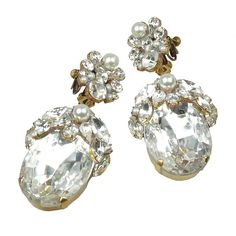 "Extravagant huge rhinestone earrings, combination of amazing rhinestones and Czech glass beads, length 3.90""      . Price: $39.90"