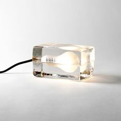 In Design House Stockholm's Block Lamp the light is enclosed by two glass blocks that feature a matt, sandblasted bulb shape. Each part of the lamp is hand cast and undergoes an extremely long cooling process to avoid cracking later on if exposed to strong temperature changes.
