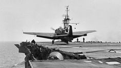 An 853 Naval Air Squadron Grumman Avenger traps aboard HMS Queen as deck crew duck under her wing. 853 Squadron operated both Grumman Avengers and Wildcats simultaneously from Queen's flight deck. They flew aboard for the first time on 27 January 1945 and remained with the ship until the end of the war.