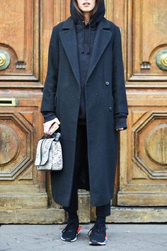 elevate a black hoodie by going monochrome with a streamlined wool coat cropped