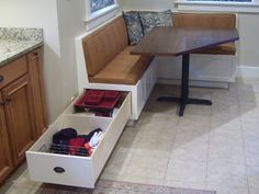 Kitchen Banquette with storage- great idea for storing tablecloths and linens