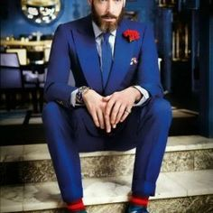 Wow...the red boutonniere and socks are just the right splash of colour. Bride could wear a red bouquet to coordinate